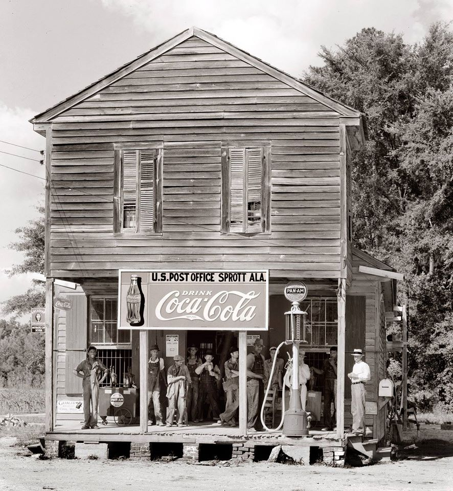 The boys of Sprott, Alabama mingle in the shade of a 1935 convenience store:post office.